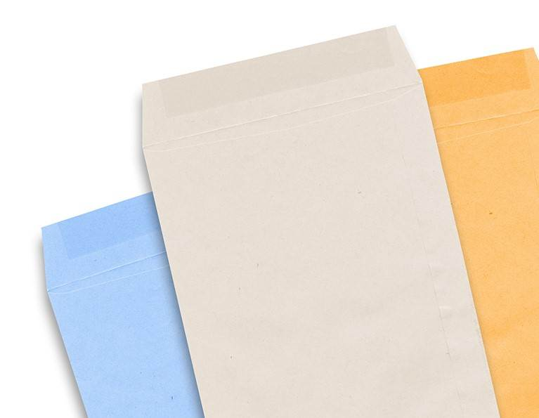Three different envelopes with the flaps open showing the gum.